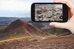 Tourist taking photo of craters volcano Etna Royalty Free Stock Photos