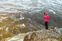 Tourist taking photo from Dalsnibba viewpoint Norway Stock Images