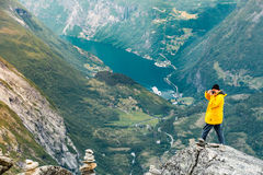 Tourist taking photo from Dalsnibba viewpoint Norway Royalty Free Stock Photography