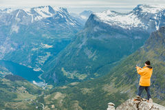 Tourist taking photo from Dalsnibba viewpoint Norway Royalty Free Stock Image
