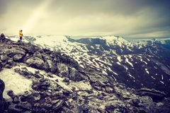 Tourist taking photo from Dalsnibba viewpoint Norway Stock Photography