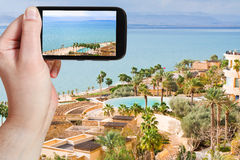 Tourist taking photo of Dead Sea in Jordan Royalty Free Stock Image