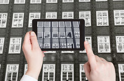 Tourist taking photo of exterior office building Royalty Free Stock Photo