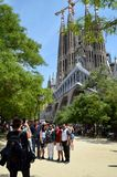 Tourist taking photo of family with La Sagrada Familia in the background stock images