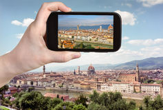 Tourist taking photo of Florence skyline Royalty Free Stock Images