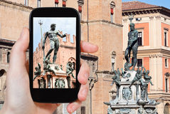 Tourist taking photo of fountain of neptune Royalty Free Stock Photo