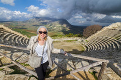 Tourist taking photo in front of greek theater of Segesta, Sicily, Italy Royalty Free Stock Photos