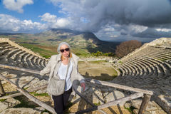 Tourist taking photo in front of greek theater of Segesta, Sicily, Italy Royalty Free Stock Images