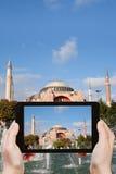 Tourist taking photo of Haghia Sophia Stock Photography