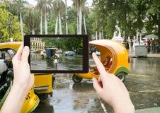 Tourist taking photo of Havana street in rain Royalty Free Stock Photo