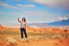 Tourist taking photo with her mobile phone in Valley of the Fire Royalty Free Stock Image