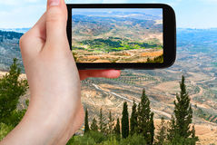 Tourist taking photo of Holy Land from Mount Nebo Royalty Free Stock Image