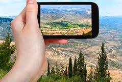 Tourist taking photo of Holy Land from Mount Nebo Royalty Free Stock Image