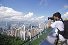 Tourist taking photo of Hong Kong Stock Images
