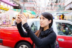 Tourist taking photo in Hong Kong Royalty Free Stock Images