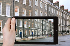 Tourist taking photo of houses in London Stock Images