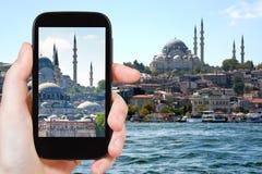 Tourist taking photo of Istanbul skyline Royalty Free Stock Image