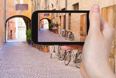 Tourist taking photo of italian medieval street Stock Photography