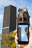 Tourist taking photo of kaiser wilhelm church Stock Photo