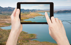 Tourist taking photo of Lake Mead in Nevada Royalty Free Stock Photos