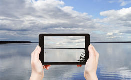 Tourist taking photo of Lake Seliger, Russia Royalty Free Stock Image