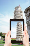 Tourist taking photo of Leaning Tower of Pisa Stock Photos