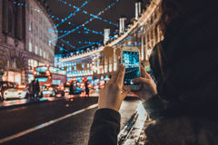 Tourist taking a photo of a London street Royalty Free Stock Images