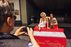 Tourist taking photo with Marilyn Monroe Royalty Free Stock Photos