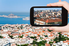 Tourist taking photo of Marseille city skyline stock images