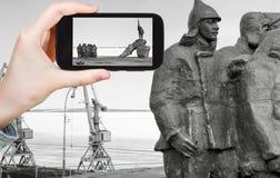 Tourist taking photo of Memorial in Anadyr town Royalty Free Stock Photos