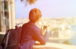 Tourist taking photo on mobile phone in Malta Stock Images