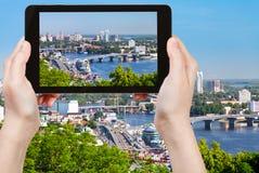 Tourist taking photo of modern Kiev skyline Royalty Free Stock Images