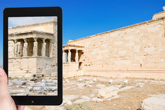 Tourist taking photo of monument at acropolis Stock Images