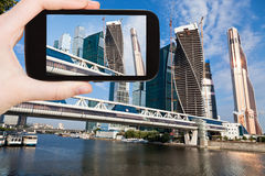 Tourist taking photo of new Moscow City and bridge Royalty Free Stock Images