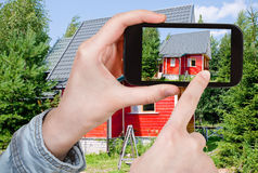 Tourist taking photo of new small country house Royalty Free Stock Photography