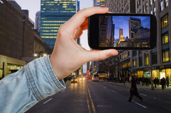 Tourist taking photo of New York City in night royalty free stock images
