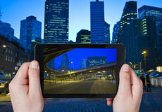 Tourist taking photo of New York City in night Stock Photo