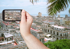 Tourist taking photo of old Havana city Stock Photos