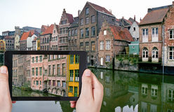 Tourist taking photo of old houses in Ghent Stock Photography