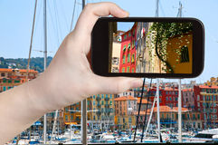 Tourist taking photo of old Nice city, France Royalty Free Stock Images