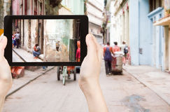 Tourist taking photo of old street in Havana Royalty Free Stock Photo