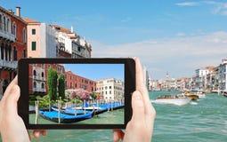 Tourist taking photo of parking of gondolas Stock Image