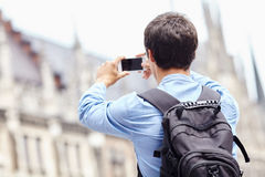 Tourist taking photo with phone Stock Photography