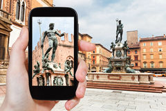 Tourist taking photo of Piazza Nettuno in Bologna Royalty Free Stock Images
