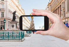 Tourist taking photo of plague column in Vienna Royalty Free Stock Images