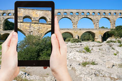 Tourist taking photo of Pont du Gard Stock Images