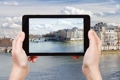 Tourist taking photo of Pont Louis-Philippe Stock Photography