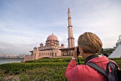 Tourist taking photo of Putra Mosque, Malaysia. Tourist taking photo of Putra Mosque in Putrajaya, Selangor, Malaysia Royalty Free Stock Photography