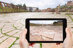 Tourist taking photo of roman oval forum in Jerash Stock Photos