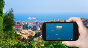 Tourist taking photo of ships near Cannes Stock Image